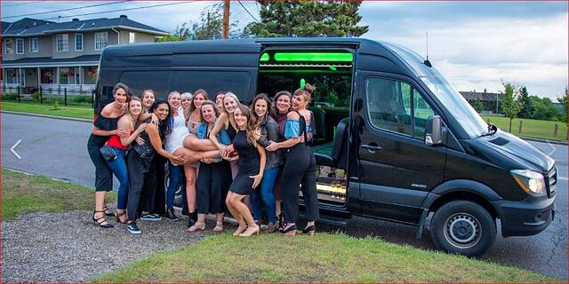 Stagette celebration group photo in front of Mercedes Mini Party Bus