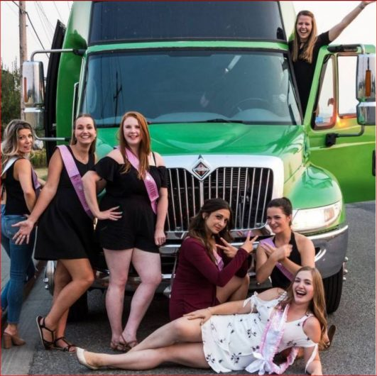 Stagette photo with 7 ladies and the Green Godzilla Party Bus