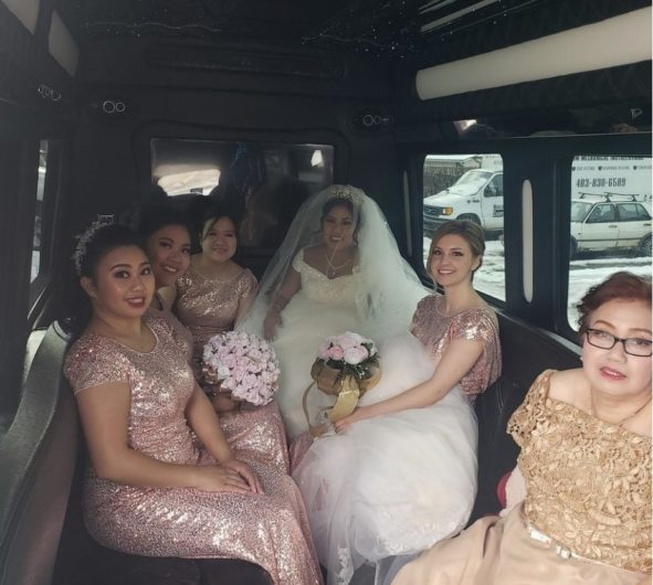 Bridal party photo inside of party bus