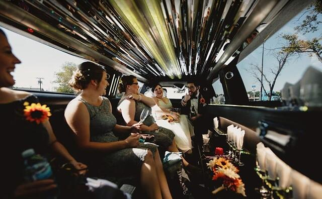 Wedding Party inside of a Limousine
