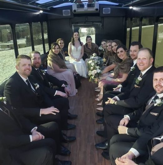 Wedding Party photo inside of a party bus