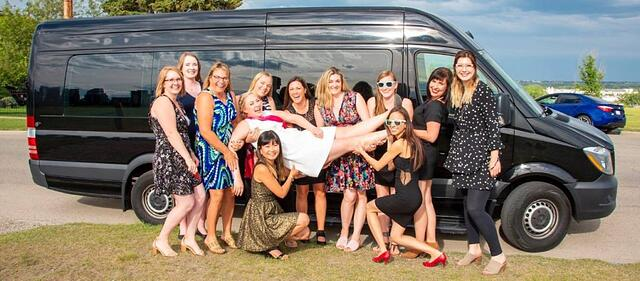 Stagette celebration in front of black Mercedes Mini Party Bus