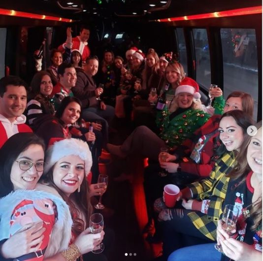 Group Christmas Party celebration inside of a party bus