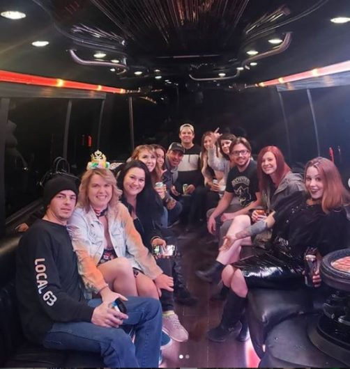 Group celebrating inside of Party Bus