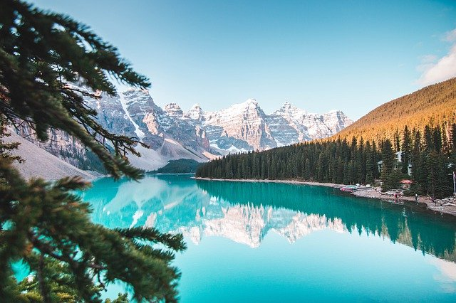 Photo of moraine lake with snowy Rocky Mountains in background